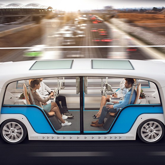 Passengers work and socialize while traveling by autonomous vehicle