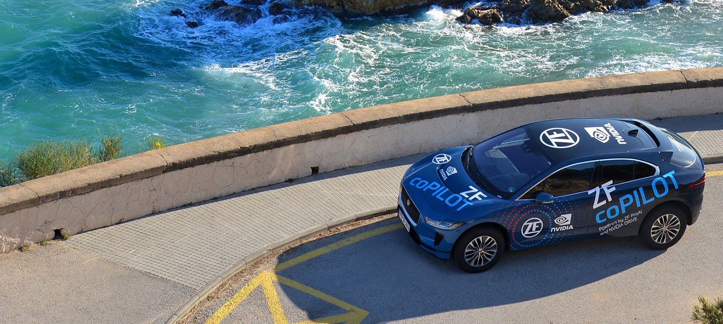Autonomous vehicle powered by ProAI is parked next to seawall