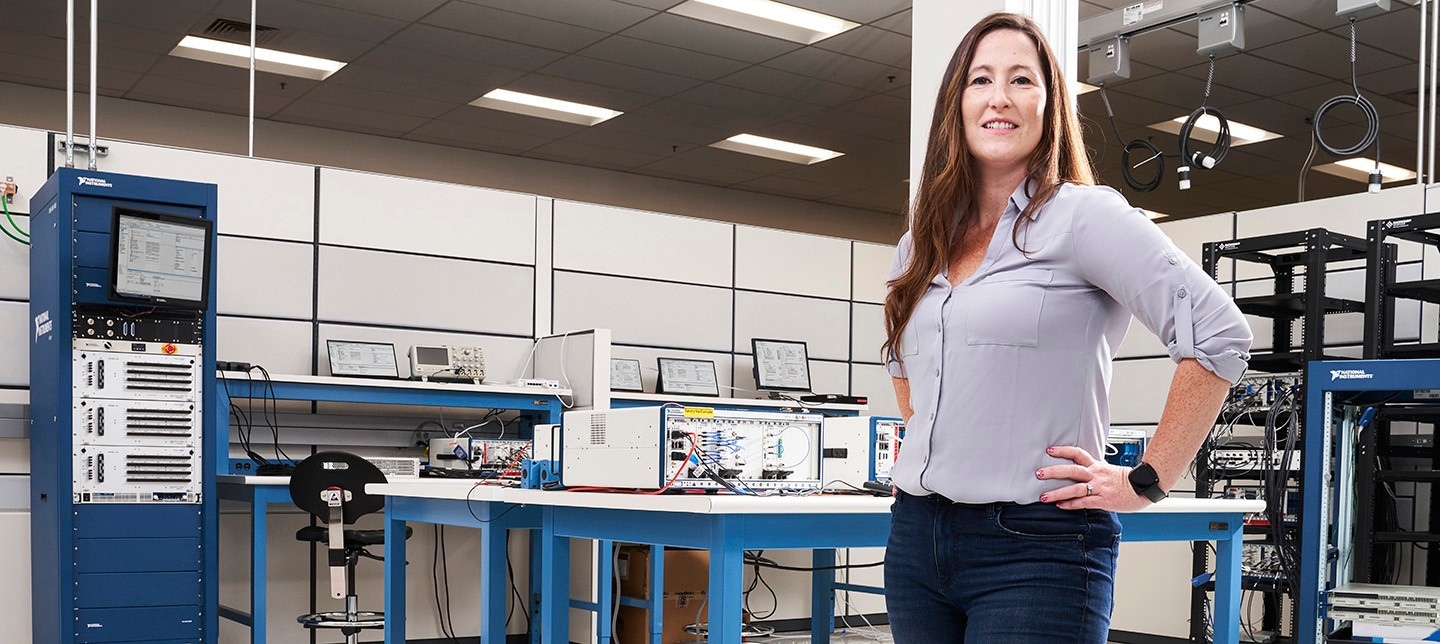 A systems engineer at NI poses in her research and development lab.