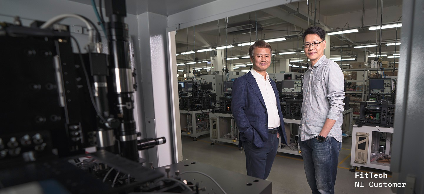 Semiconductor test engineers stand on the production floor of FitTech