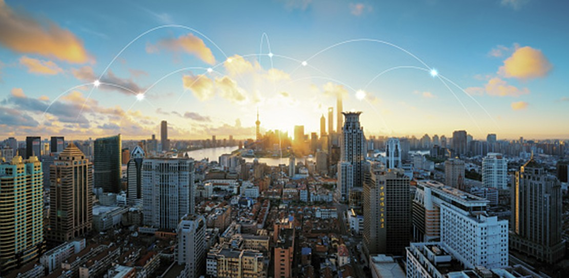Aerial view of modern city with illustrations of 5G signals over airwaves