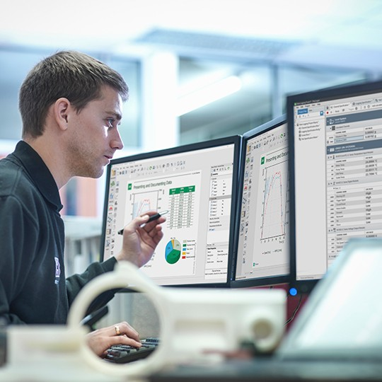 An engineer gains insights from tests using NI application software