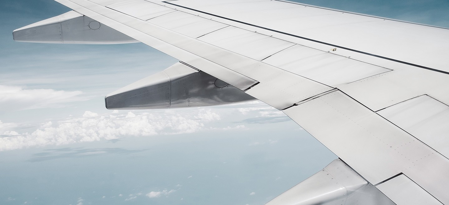 View of a commercial jet wing as seen from passenger seat