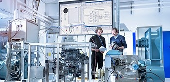 Two engineers conduct a hardware-in-the-loop simulation in a laboratory