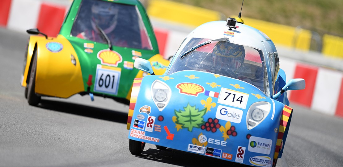Drivers race energy efficient vehicles around the track during the Shell Eco-marathon