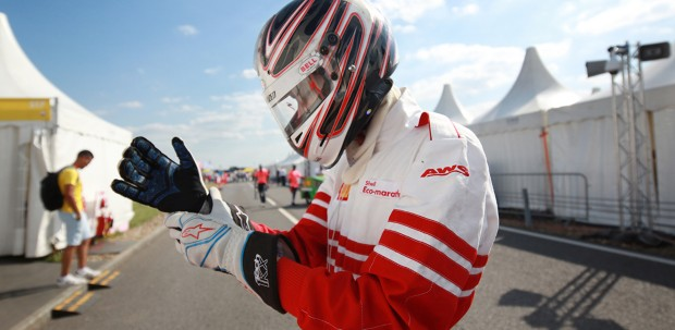 A driver dons protective gloves in preparation for the Shell Eco-marathon