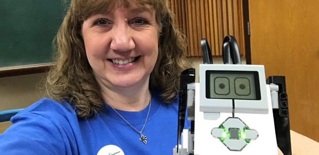 Heidi Frock holds a robotic puppy after volunteering with Girl Day.