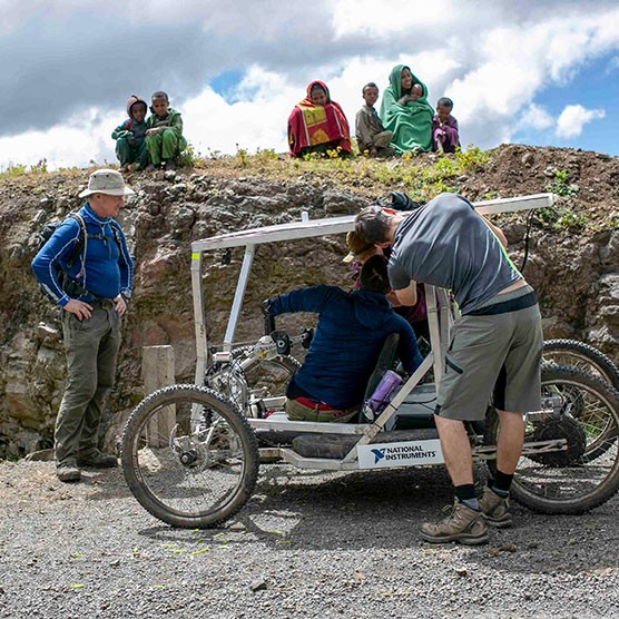 A team of engineers tests an electrically-assisted handcycle for safety with its driver