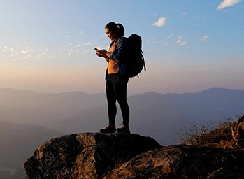 A hiker uses GPS in her phone to find her way.