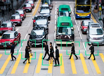 Sensors on autonomous vehicles detect pedestrians on a busy city street.